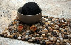 I'd like to make this river rock mat to put a small bamboo vase on. For the bathroom?