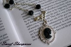 Black and white Gothic Lolita skull cameo necklace.    www.etsy.com/shop/SweetSharpness