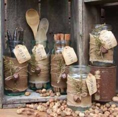 Primitive jars wrapped in Cheesecloth with twine and rusty bells