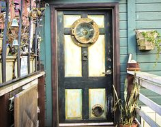 porthole window front door - look down the bottom at the cat flap! omg
