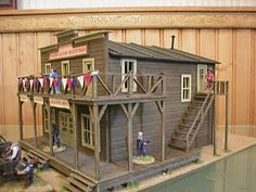 a nice big building with lots of play-ability. i really like the bunting which ads a party feel to the model. Big Building, Building Plans, Old Western Towns, Old West Town, Western Saloon, Ho Scale Buildings, Westerns, Store Layout, Model Train Layouts