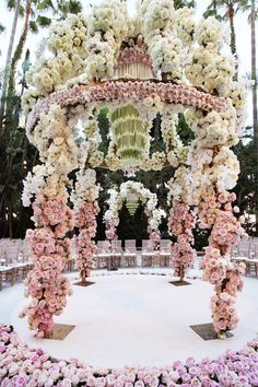 Unbelieveable ceremony canopy with exquisite floral - we love this one!