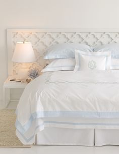 loving the headboard...good idea to take it behind the night stand so than you dont need to put mirror or picture