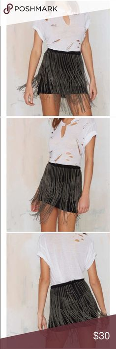 """#76 chain bae mini skirt 🐥 Chain bae in a real way. This skirt is made in a black knit and features tiered chain trim at front and back. Fully lined, back zip closure. Insane with a shredded tee and ankle boots, or dressed up with a plunging bodysuit and peep-toe booties.  *Polyester/Spandex  *Runs true to size  *Model is wearing size small  *15.5""""/39.4cm from waist  *Hand wash cold  *Imported Nasty Gal Skirts Mini"""