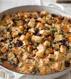 This bread pudding-like stuffing, which you can make ahead, stays moist from the eggs and cream.