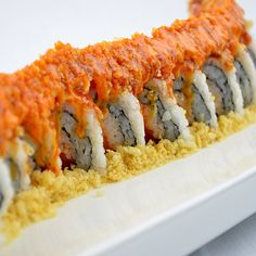 Fire Cracker Roll: Spicy Tuna, Spicy Salmon, Mayo, topped with Tempura Crunch