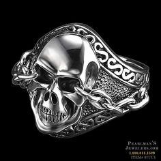 A stylized man's engraved skull ring from Scott Kay. This ring is made of sterling silver. At its widest point on the front side of the ring it is 1 inch wide and 3/8 inch thick; on the back side it's 1/4 inch wide. The ring weighs 1 ounce. This Can come in sizes ranging from 8-11.