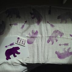 Giant bears tamp on a baby blanket. #yellowowlslittleprints