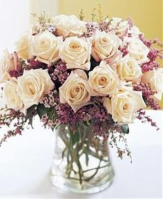 heather looks delicate combined with roses (maybe not my dream bouquet but could consider in the centerpieces!)