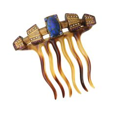 Edwardian Hair Comb with purple clear and blue crystal accents featuring a large blue glass cabochon. Stamped September 14, 1915.