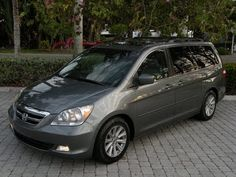 """Auto Haus of Fort Myers is offering this Recently Serviced & Inspected, 2007 Honda Odyssey Touring with only 62k Miles for $18,900. It comes nicely equipped with a Nimbus Grey Metallic Exterior, Grey Leather Interior, 3.5L V-6, Automatic Transmission, Navigation System, Honda Premium Audio with CD/DVD Changer, Rear DVD Entertainment, Rear Backup Camera with Park Assist, Power Heated Seats,17"""" Alloy Wheels & Much More. Call Auto Haus of Fort Myers at 239-337-HAUS (4287)"""