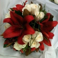 Must have red lillies. Not necessarily in a bouquet.
