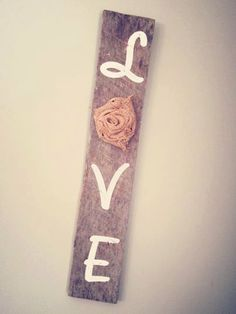 Painted Love sign on reclaimed wood with a fabric rosette. Love this!! So cute and only $20!!
