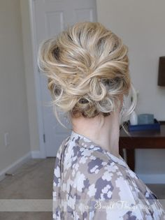 "The Messy Side Updo: I don't know how ""side"" this is, but it looks pretty easy and would be a great second day look after you've curled your hair on the first day (assuming that your curl holds that long like mine does)"