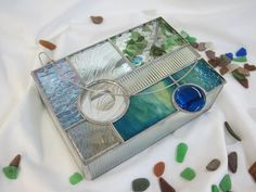 """beautiful handmade art glass with various clear textures, bevels and jewels. The main colors are blues, greens and a touch of purple. The mirrored bottom adds sparkle, and each has decorative wire work on the lid that also acts as a stopper! This box measures 5"""" x 7"""" x 2 Geometric+Stained+Glass+Box+by+RenaissanceGlass+on+Etsy,+$95.00"""
