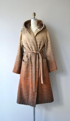 Vintage 1970s Luba wool wrap coat with ombre stripe, large pockets, attached hood and tie belt. No lining. The coat does button at the top as well, shown with collar open. --- M E A S U R E M E N T S --- fits like: fits most shoulder: 17 bust: up to 49 waist: ties to fit hip: free sleeve inseam: 19: shoulder to cuff (cuff is adjustable in width): approx. 30 length: 47 brand/maker: Luba condition: excellent ✩ layaway is available for this item ➸ More vintage coats http://www.etsy.com/shop/...