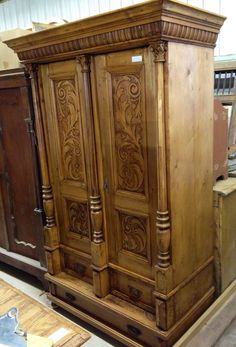 This Antique Handcarved Pine Armoire is imported from Eastern Europe. It has beautiful designs and provides extra storage. Perfect for the charming home without large closets.