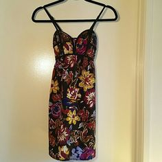 Xhilaration Bustier Floral Patterned Dress Sz XS Such a fun, unique, comfortable dress! Black trim along bustier-style top w/ flattering seams & stitching throughout. The back of the top is smocked for a great fit, & it has adjustable spaghetti straps. The skirt is flowy & very forgiving, since it's somewhat of an empire hem. 70s inspired floral print w/ blues, purples, cream, olive, & browns on black bg. Great w/ boots & a moto jacket or flats & a cardi! NWOT, bought & just never wore…