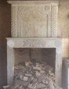 Decorative and charming late 18th Century antique French limestone entrumeau fireplace for sale on SalvoWEB from Wharton Antiques in Somerset [ Salvo code dealer