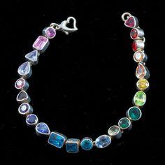 Rainbow Tennis Bracelet - Sterling Silver & CZ. $180.00, via Etsy.