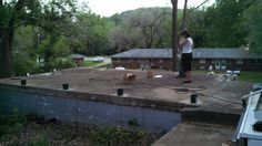 Time to begin the patio railing...got the post boxes anchored to the concrete