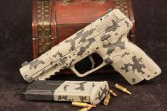 FN Herstal 5.7 in digital camo FN five-seven SPECIFICATIONS:  Caliber: 5.7×28mm Barrel: 4.8 inches Overall Length: 8.2 inches Weight (unloaded): 625 grams (1.39 lbs.) Grips: Polymer Sights: Fixed 3-dot combat sights with optional self-luminous tritium elements Action: SA, delayed blowback Finish: Black Capacity: 20 (10 where restricted)