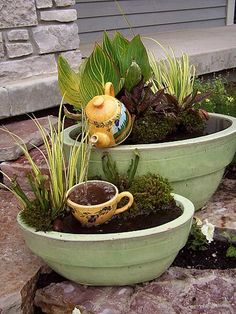 I really like this!! Container Water Gardens  A whimsical fountain created with a teapot and cup.