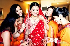 South asian bride and her bridesmaids photo by aaroneye-photography indian wedding, red saree, bridal clothing
