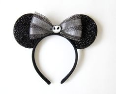 Jack Skellington inspired Mickey/ Minnie Mouse Ears Features a big spiderweb Made from soft material so its comfortable to wear all day Jack Skellington in