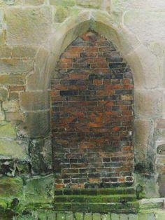 12th Century bricked up arch doorway to crypt, Parish Church of St Peter & St Paul, Kingsbury, Warwickshire.