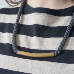 Did you see our fun new rope necklaces with a single long brass bead?