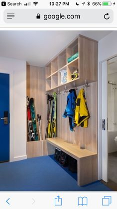 A cobalt blue door leads directly into a small entryway that's lined with custom cabinets for the family's skis, hats, boots, and jackets. Also created by David Amble Cabinetry, the trough is lined with copper so that they can put their wet skis inside. Lake Tahoe, Chalet Ski, Drying Room, Modern Hallway, Small Entryways, Small Space Organization, Organizing Ideas, Loft, Built In Storage