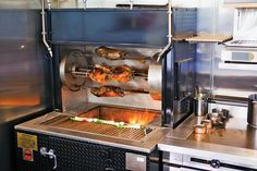 Chickens, game birds, rabbits, and legs of lamb turn above the flames on the J Manufacturing rotisserie at Thomas McNaughton and his Flour + Water partners' new Central Kitchen    —Jennifer Martiné