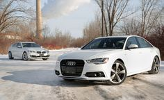 2014 Audi A6 TDI vs BMW 535d. For more, click http://www.autoguide.com/car-comparisons/2014-audi-a6-tdi-vs-bmw-535d-3756.html