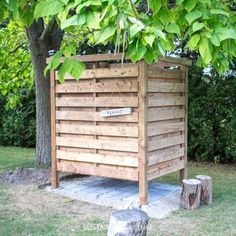 DIY Outdoor Shower Enclosure Plans [with VIDEO!] DIY outdoor shower enclosure built of wood slats under a catalpa tree Outdoor Pool Shower, Portable Outdoor Shower, Outdoor Shower Fixtures, Outdoor Shower Enclosure, Outdoor Bathrooms, Outdoor Toilet, Outside Showers, Outdoor Glider, Outdoor Pillow