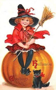 red head witch on pumpkin