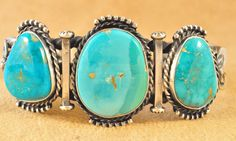 Handmade twisted cuff bracelet, with natural gem grade Royal Blue Turquoise, by Navajo artist Kelly Morgan.