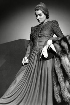 Brenda Marshall, 1940s Pleats, zips, ruching, AND statement headwear? So many trends. We can't get enough of Brenda's turban.