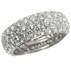 Tiffany Etoile Five-Row Diamond Platinum Band Ring | Tiffany & Co. Etoile five-row diamond band ring with round brilliant diamonds pave-set in platinum. The total diamond weight is 3.30 carats. The band measures approximately 7.3 mm in width. Circa 2013. #CraigEvanSmall