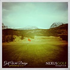 Homeward bound on the back nine with mountain views.