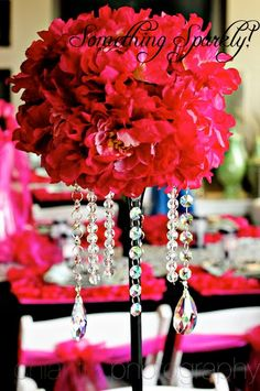 Hanging crystals from tall flower arrangements