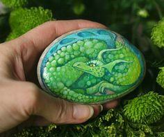 Stone with a hand-painted smiling dragon by SkadiaArt on Etsy