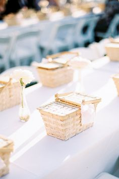 "From the editorial ""This Brides Cost-Cutting Ideas Look Like A Million Bucks."" Following the ceremony, guests were delighted by a picnic-style dinner featuring wicker baskets that were later used as favors guests could bring home. How adorable are these?!  Photography: @justinewrightphoto  #weddingfavors #weddingfavor #uniquefavorideas #picnicwedding #fallweddingideas"