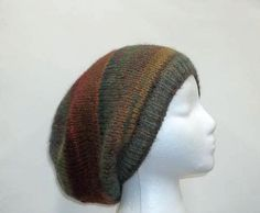 Knit Beanie Beret Slouchy colorful wool blend hat by CaboDesigns, $27.00- The colors in this knit beanie beret slouchy are several shades of brown, rust, teal, green, dark orange, a large variety of colors. Very stretchy, will fit any head, stretches out to 31 inches around. The yarn is 53% wool and 47% acrylic. Very soft.Available at:  http://www.CaboDesigns.etsy.com