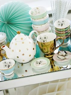 Tea party time - tea pot and cups, small bowls and tiny cake plates  + paper decorations #pompon Miss Etoile van: http://www.missetoile.dk/
