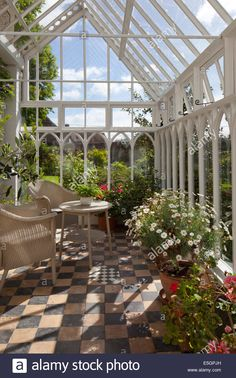 Interior of old style English wooden conservatory with wicker seating and flower pots - Stock Image Interior of old style English wooden conservatory with wicker seating and flower pots - Stock Image What Is A Conservatory, Victorian Conservatory, Conservatory Garden, Indoor Greenhouse, Small Greenhouse, Greenhouse Plans, Pallet Greenhouse, Homemade Greenhouse, Portable Greenhouse