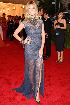 Heidi Klum showed off her incredible body in a custom blue lace Escada gown with a sheer skirt and statement necklace.