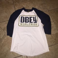 """Baseball Tee Navy blue arms quarter length, and white with gold border around """"obey"""" (Mens Sz: S but the fit of maybe an XS) Obey Tops Tees - Long Sleeve"""
