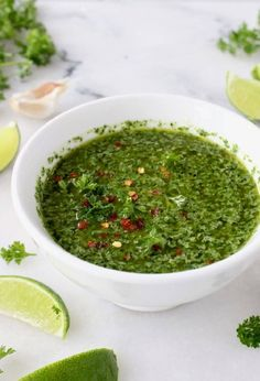 The absolute best Argentinian chimichurri sauce recipe. A perfect marriage between garlic, parsley, oregano, cilantro and lime.