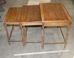 FROM THE HERITAGE FURNITURE COMPANY ARE THESE NESTING TABLES. DONE IN MAHOGANY WITH A BAMBOO LOOK TO THE LEG. THE LARGEST IS 26 X 17 X 22 AND THE SMALLEST IS 20 X 13 X 20.